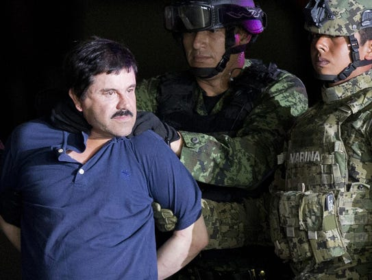 In this Jan. 8, 2016 file photo, a handcuffed Joaquin