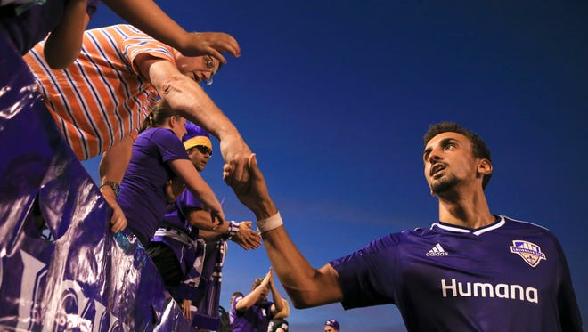 Louisville FC fans greet players after the words the match ended in a draw 1-1 Saturday night against Charleston.