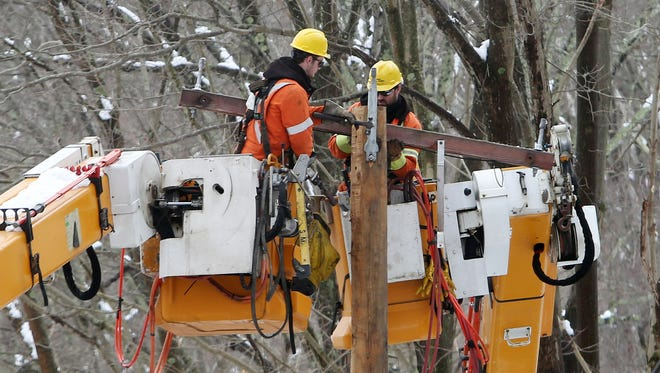 2:16 p.m. A utility company from Quebec, Canada, helps out NYSEG by repairing down power lines along Croton Falls Road in Somers March 8, 2018.