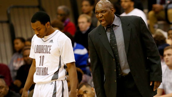 Lawrence Central head boys basketball coach Albert Gooden gets after his player Eric Ross (10) during a dead ball against Carmel on Dec. 4, 2015.
