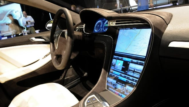Tesla is under fire from PETA for its leather interiors. One shareholder proposal would eliminate leather by 2019.