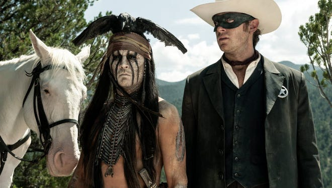 """Johnny Depp as Tonto and Armie Hammer as The Lone Ranger in a scene from """"The Lone Ranger"""" in 2013. Native American leaders and educators question Depp's claims of Cherokee heritage."""