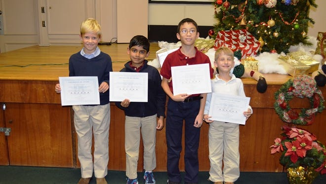 1st Place Winners from left to right--Andrew Ewald (3rd grade); Advaith Subramaniam (2nd grade); Alex An (5th grade), Jack Bryant (1st grade); 4th grade winner not shown, Amira Williams