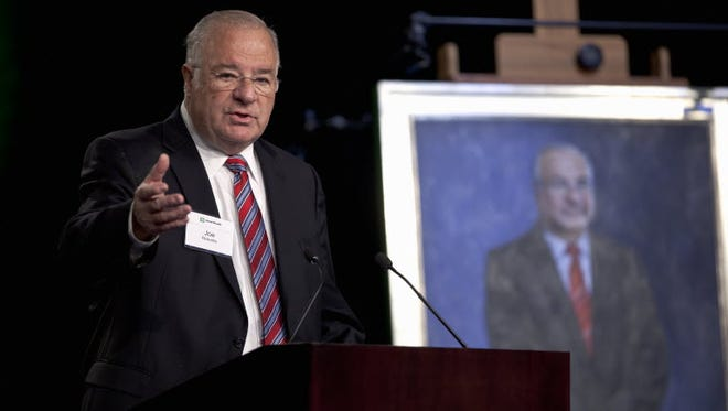 Online brokerage TD Ameritrade founder Joe Ricketts speaks Tuesday, Feb. 14, 2012, during a ceremonial unveiling of his portrait. Rickets abruptly shut DNAInfo and the Gothamist web sites Thursday.