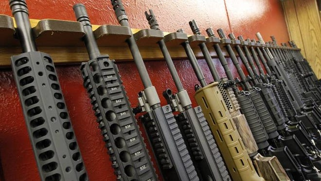 A row of different AR-15 style rifles are displayed for sale at the Firing-Line indoor range and gun shop, Thursday, July 26, 2012 in Aurora, Colo. (AP Photo/Alex Brandon)