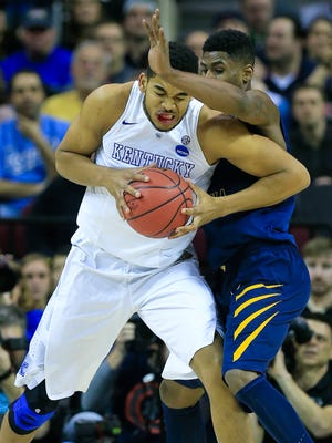 Kentucky's Karl-Anthony Towns had a bloody lip in the first half during Thursday evening's Sweet 16 game in Cleveland. The Wildcats rolled past the Mountaineers 78-39. March 26, 2015.