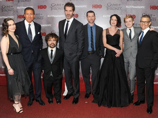 """(From left): Emilia Clarke, Richard Plepler, Peter Dinklage, David Benioff, D.B. Weiss, Lena Headey, Jack Gleeson and Michael Lombardo attend the """"Game Of Thrones"""" Season 4 New York premiere at Avery Fisher Hall, Lincoln Center on March 18, 2014 in New York City."""