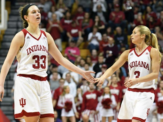 Indiana Hoosiers forward Amanda Cahill (33) and Indiana Hoosiers guard Tyra Buss (3) high five during the game against TCU at Simon Skjodt Assembly Hall in Bloomington, Ind., on Wednesday, March 28, 2018.