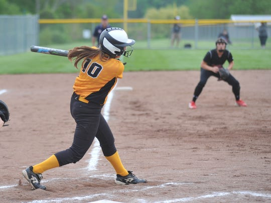 Karlie Kurtzman swings at a pitch in the district semifinal.