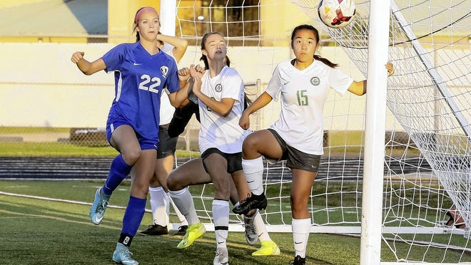 Sophomore defender Madison Fullerton (middle) and senior defender Marian Krier (right) are among the top returnees for the Scioto girls soccer team, which began OCC-Capital Division play Sept. 1 by defeating Westerville South 3-0.
