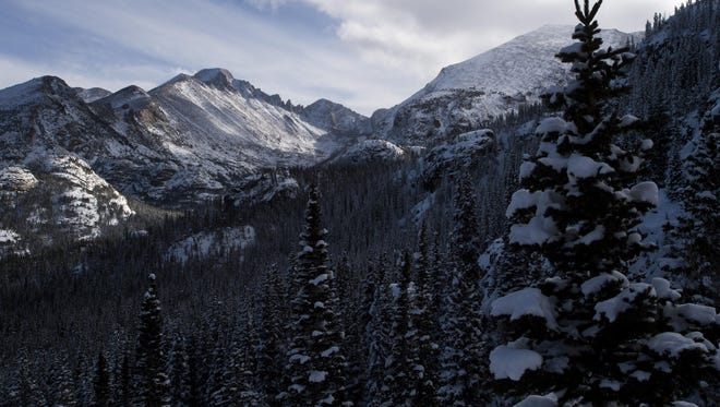 Longs Peak in Rocky Mountain National Park is blanketed in snow in this file photo. A hiker was found dead on a trail in the park on Feb. 27, 2016.