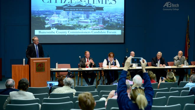 Brownie Newman, the Democratic candidate for chair of the commission, gives his opening statement during the Asheville Citizen-Times Buncombe County Commissioners Candidate Forum at the Ferguson Auditorium on the campus of Asheville-Buncombe Technical Community College on Thursday, Sept. 22, 2016.