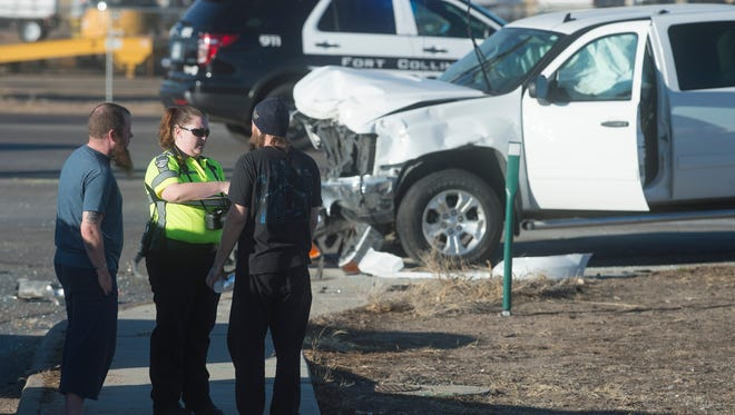 Emergency personnel respond to a crash involving a truck and sedan at the corner of CO 14 and Frontage Road east of I-25 in Fort Collins on Wednesday, February 15, 2017.