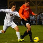 Hartland's Hans Ooms is in pursuit of Brighton's Lucas Miller Thursday night. The Bulldogs won, 2-0.
