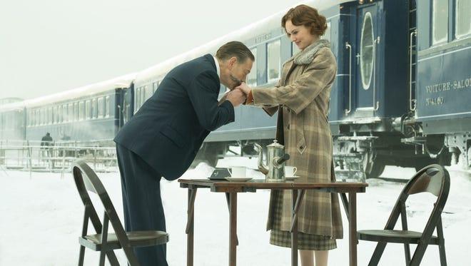 "Hercule Poirot (Kenneth Branagh) and Miss Mary Debenham (Daisy Ridley) share a moment in Twentieth Century Fox's ""Murder on the Orient Express."""