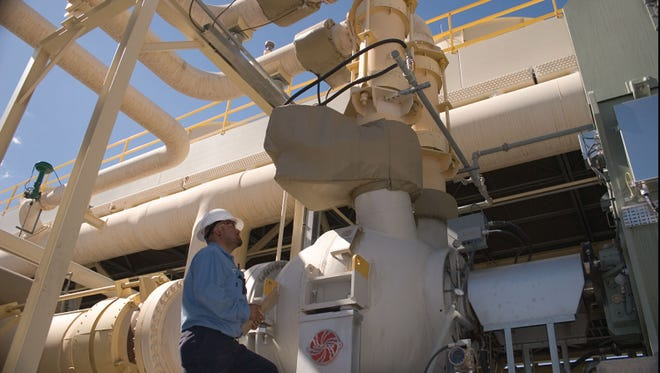 A worker at Ormat'ss Galena III geothermal plant in Nevada.