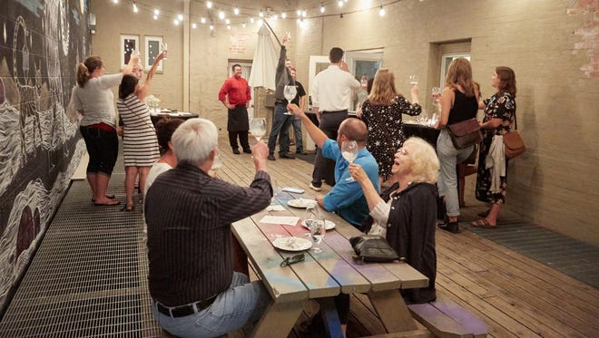 Guests enjoy cocktails from Loren Matthews of Elevation 5003 Disterllery and small bites from Chef Brett Oberhammer of The Still Whiskey Steaks during Coloradoan Experiences' August Pop-Up Pairing at the Downtown Artery, August 22, 2017.