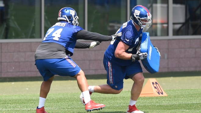 New York Giants offensive tackle Ereck Flowers (74) and tackle Nate Solder, right, workout during OTA's in East Rutherford, NJ on May 29, 2018.