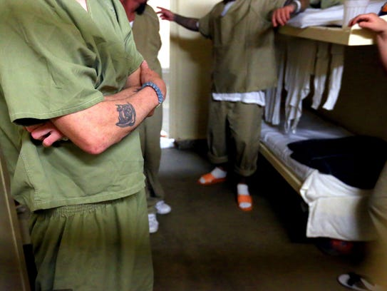 Male inmates talk to Sheriff Jim Kaelin in a cell Thursday,