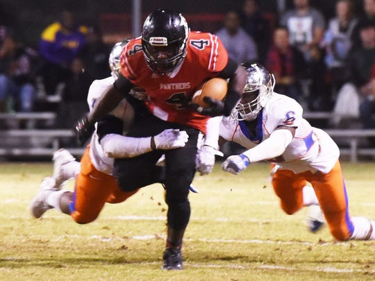 Parkway's Eric Williams tries to get past Landry-Walker's defense in the 5A playoff football game Friday evening at Parkway's Preston Crownover.