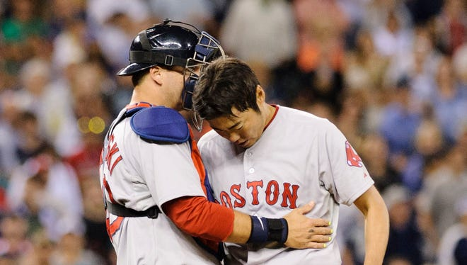 Boston Red Sox catcher A.J. Pierzynski (40) talks to Boston Red Sox relief pitcher Koji Uehara (19) during the ninth inning at Safeco Field.