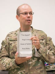 York County Clerk of Courts Don O'Shell shows off his mini T-wall from his time in Afghanistan during a meeting with his co-workers Tuesday, June 28, 2016, at the judicial center. O'Shell was in Afghanistan for four months as an air adviser for the 438th Air Expeditionary Wing. Amanda J. Cain photo