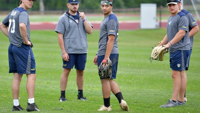Members of the Worcester Bravehearts held practice at St. John's High in Shrewsbury on Monday.