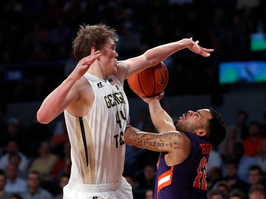 Clemson guard Avry Holmes (12) and Georgia Tech center Ben Lammers (44) battle for a rebound in the second half of an NCAA college basketball game Thursday, Jan. 12, 2017, in Atlanta. Tech won 75-63. (AP Photo/John Bazemore)