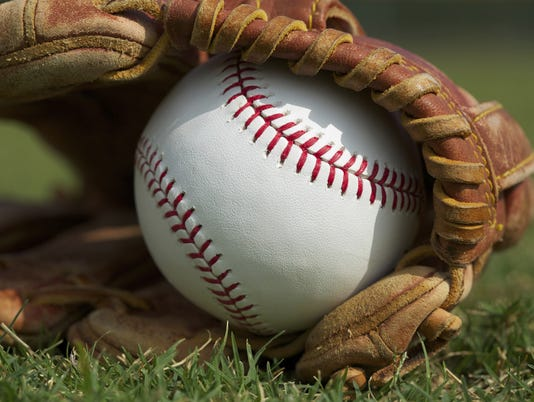 636268734106221435-baseball-glove-grass.jpg