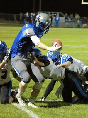 Montezuma players including Shane Helm, 13, Logan Price, 14, and Zach Townsend, 5, push Gladbrook-Reinbeck's Matt Roeding, 5, out-of-bounds during the Rebels' 35-0 win in the Class A quarterfinals.