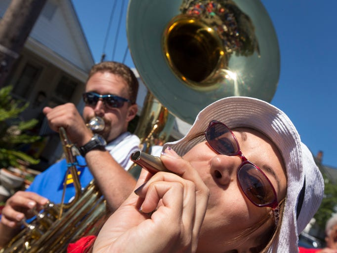 Jeff Brown of Howell and Tina Kaye of Brick warm up with the Kazoo Marching Band in the Ocean Grove Fourth of July Parade celebrated on July 5, 2014 in Ocean Grove NJ. Photo by Peter Ackerman