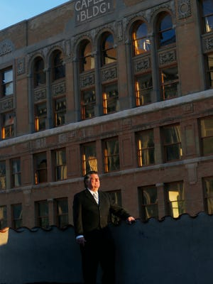 """William """"Billy"""" Abraham stands on a Downtown El Paso building roof with his historic Caples Building in the background. Abraham in bankruptcy court documents reports he received a past sale offer of $3.1 million for the 108-year-old building at 300 E. San Antonio."""