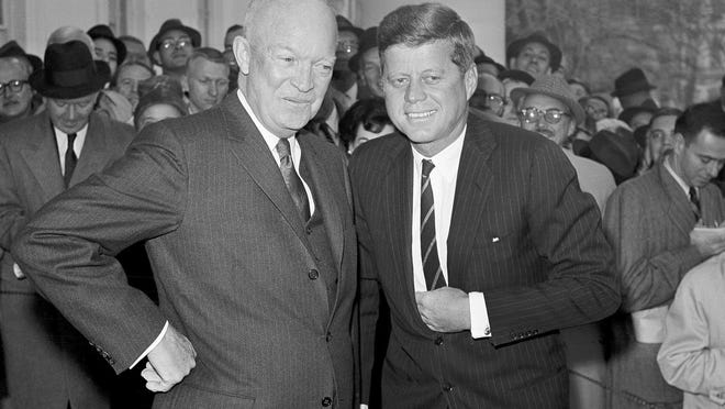 In this Dec. 6, 1960, file photo, President Dwight Eisenhower poses with President-elect John F. Kennedy at the White House in Washington, before a private conference.