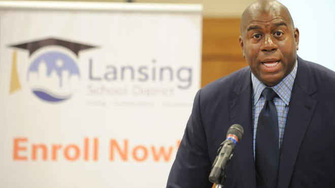 """Earvin """"Magic"""" Johnson Jr. spoke to staff members at the Lansing School District and the school board Tuesday as he visited Lansing and two schools."""