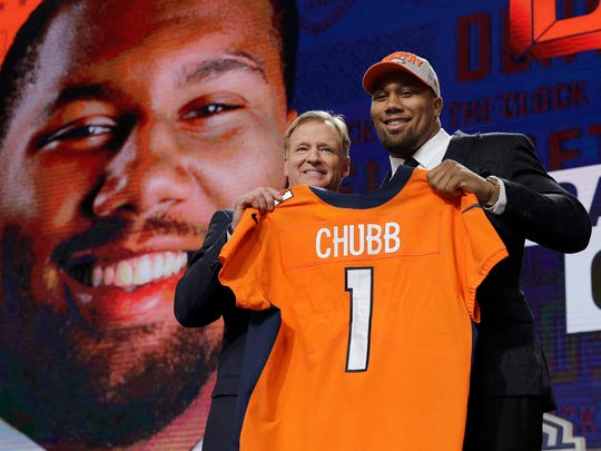 Commissioner Roger Goodell, left, poses with North Carolina State's Bradley Chubb after Chubb was selected by the Denver Broncos during the first round of the NFL football draft, Thursday, April 26, 2018, in Arlington, Texas. (AP Photo/David J. Phillip)