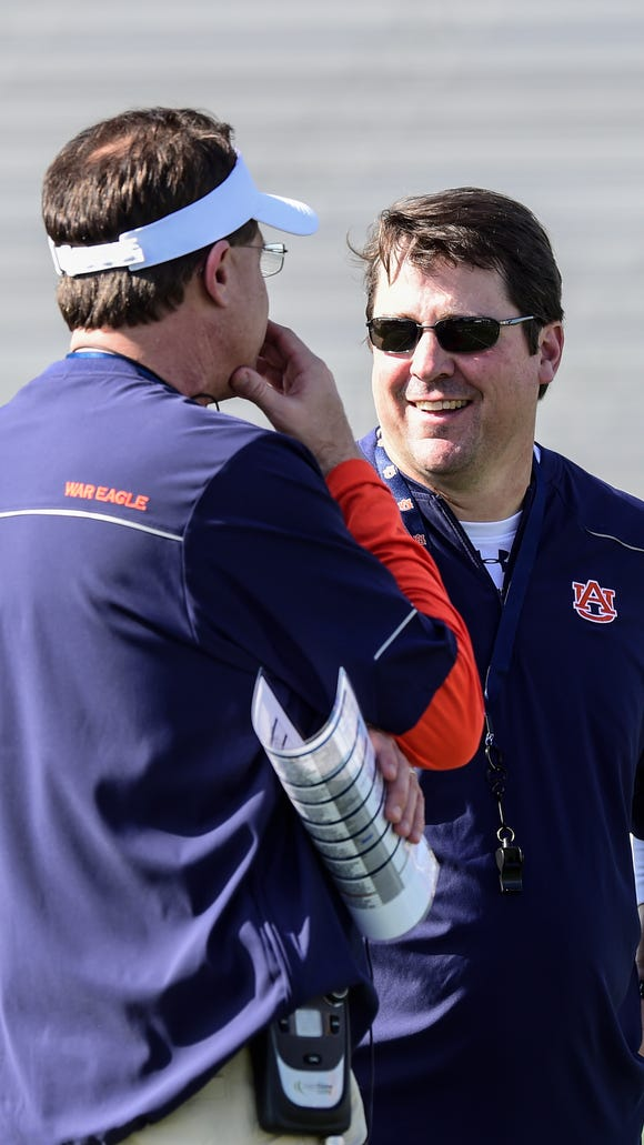 Will Muschamp talks with Gus Malzahn during a practice before the Outback Bowl.