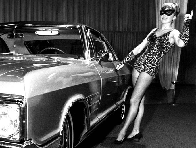 A promotional model poses with the Buick Wildcat at