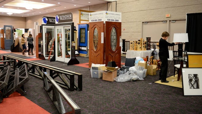 Vendors set up their exhibits Tuesday for the Brown County Home Builders Association 2015 Home Expo, which begins Thursday.