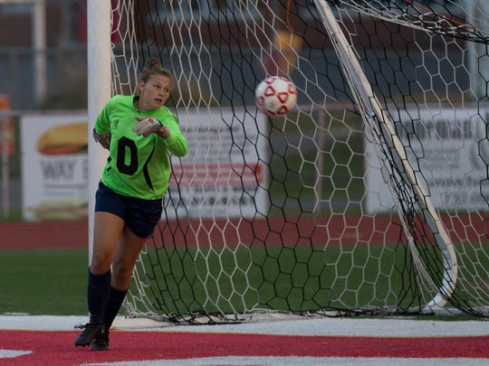 Toms River North goalie Cameron Kennett can't get to shot  by Wall's Jenna Karabin during closing minutes of first half. Toms River North Girls Soccer vs Wall in SCT Tournament Semifinal at Ocean Twp. High School on October 25, 2017.