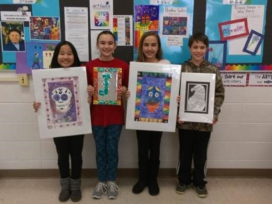 Artwork by Weston Elementary fifth-graders, from left, Tae Vang, Janell Russ, Kyleigh Grahn and River Zastrow will be displayed at the Woodson Art Museum from Feb. 25 until April 2.