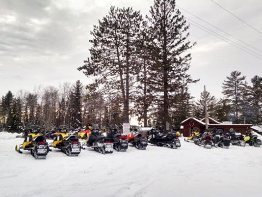 636476613644281595-Parked-Snowmobiles-Courtesy-of-Hayward-Lakes-VCB.jpg