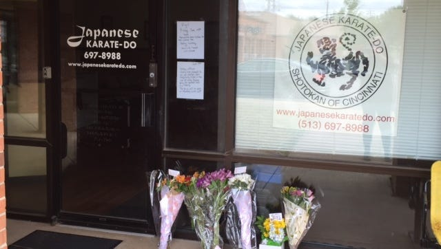 Well-wishers left flowers and notes outside Japanese Karate-Do Dojo, where Sonny Kim taught.