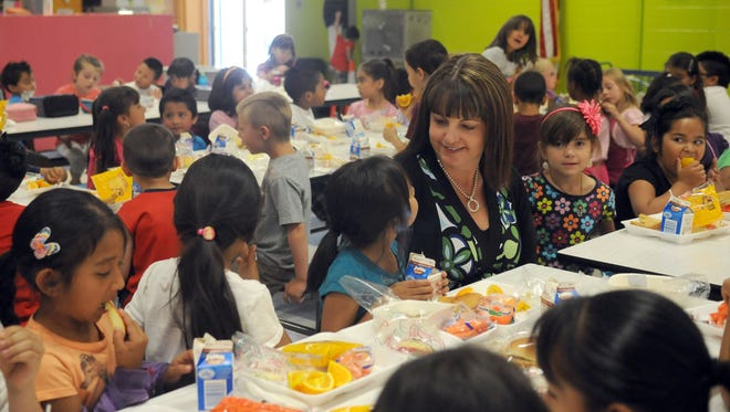 In 2009: Principal Denise Dufrene sits with students at Alice Maxwell School, one of four overcrowded Washoe County schools.