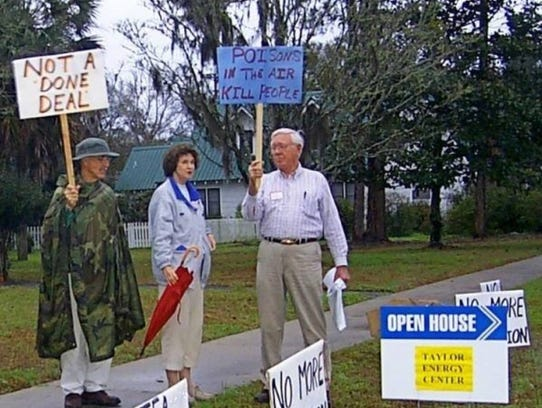 Bob Fulford, right, plus John and Gale Dickert protest
