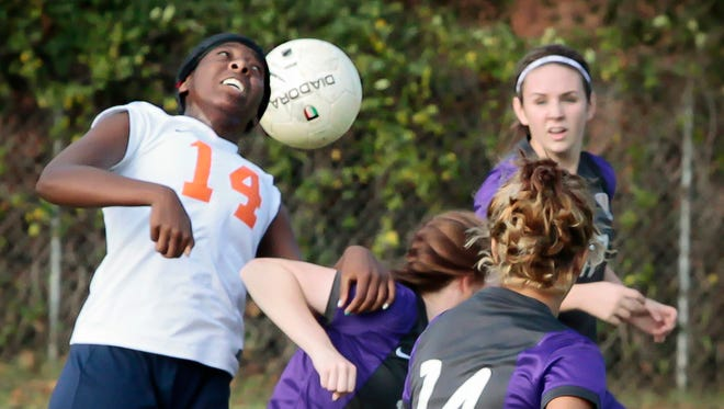 Blackman's Carrington McKenzie heads a ball with a wall of Smyrna players defending the play during Monday's 4-0 win over the Lady Bulldogs in the District 7-AAA quarterfinals. Blackman plays Oakland at 6 p.m. Tuesday at Richard Siegel Soccer Complex in the District 7-AAA semifinals.
