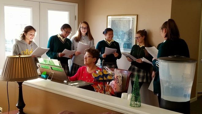 When Our Lady of Mercy Academy students visit Maurice House, there's holiday fun for everyone including singing and dancing.
