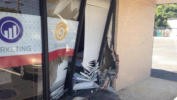 A car smashed into Allegra Allegra Design, Print and Mail at the corner of Hollywood Drive and Old Hickory Boulevard early Thursday afternoon.