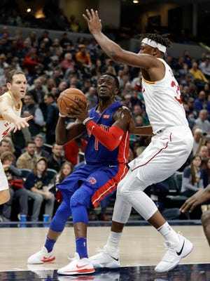 Pistons guard Reggie Jackson goes to the basket against Pacers center Myles Turner during the first half on Friday, Nov. 17, 2017, in Indianapolis.