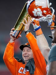 Clemson head coach Dabo Swinney lifts the National