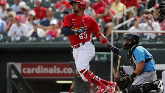 The St. Louis Cardinals' Edmundo Sosa singles during the second inning of a spring training baseball game against the Miami Marlins on Feb. 26 in Jupiter, Fla.